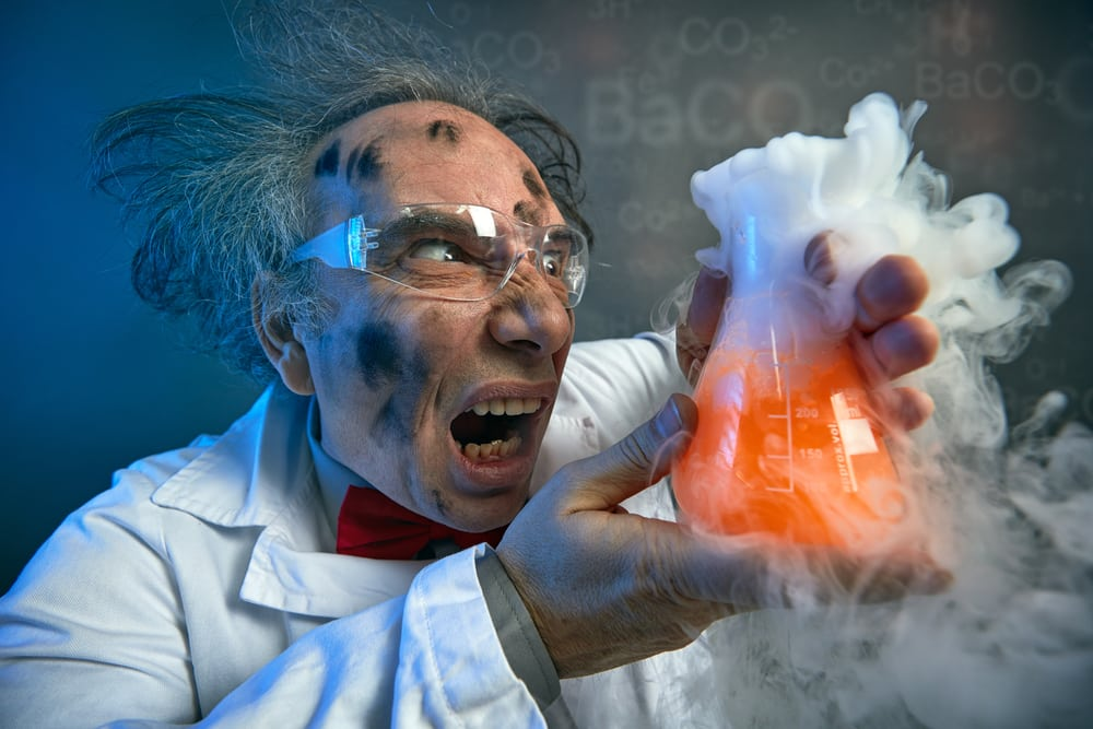 Angry scientist with his failed experiment, yelling on test tube