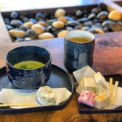 cup of japanese tea and snacks