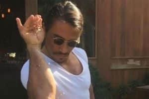 salt bae doing his signature move