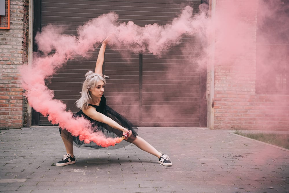 Sabrina dancing with pink smoke