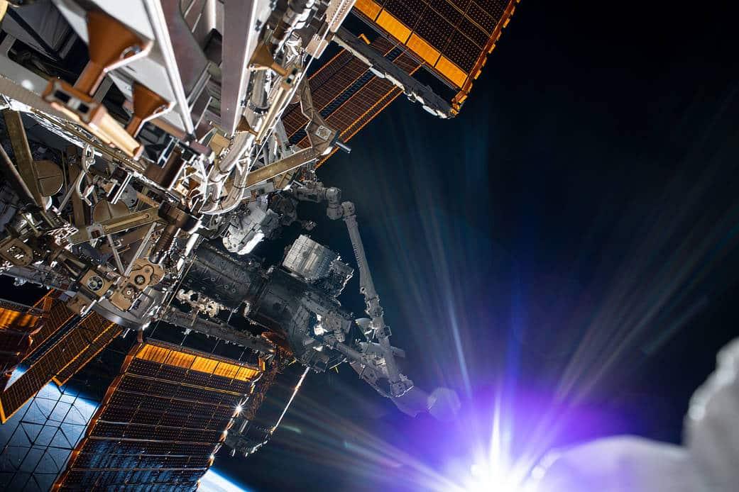 sun shining on ISS