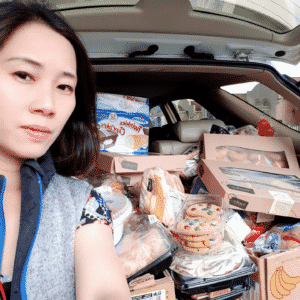 Rose and her car full of supplies