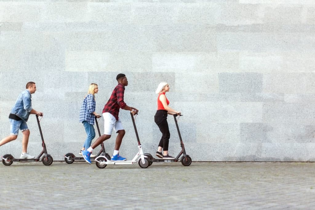 friends on scooters exploring San Francisco on an outdoor escape game