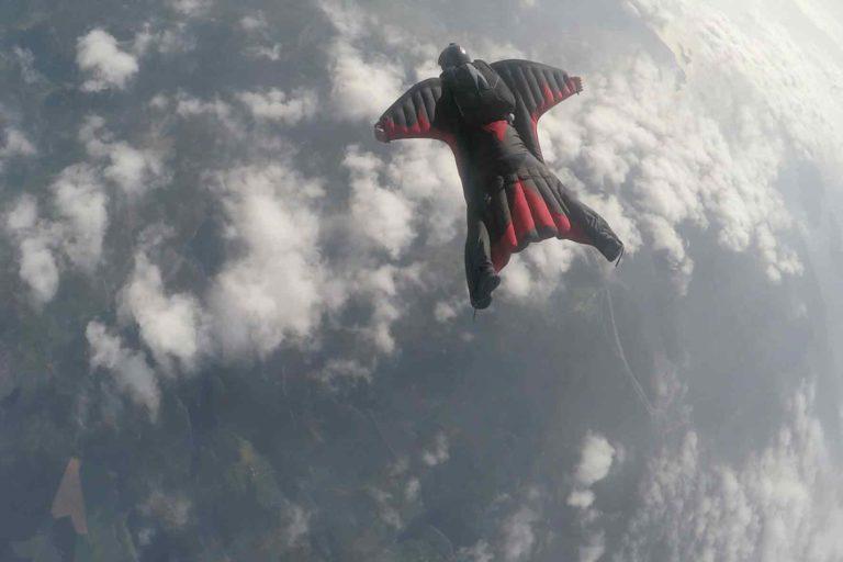 men skydiving in a wing suit